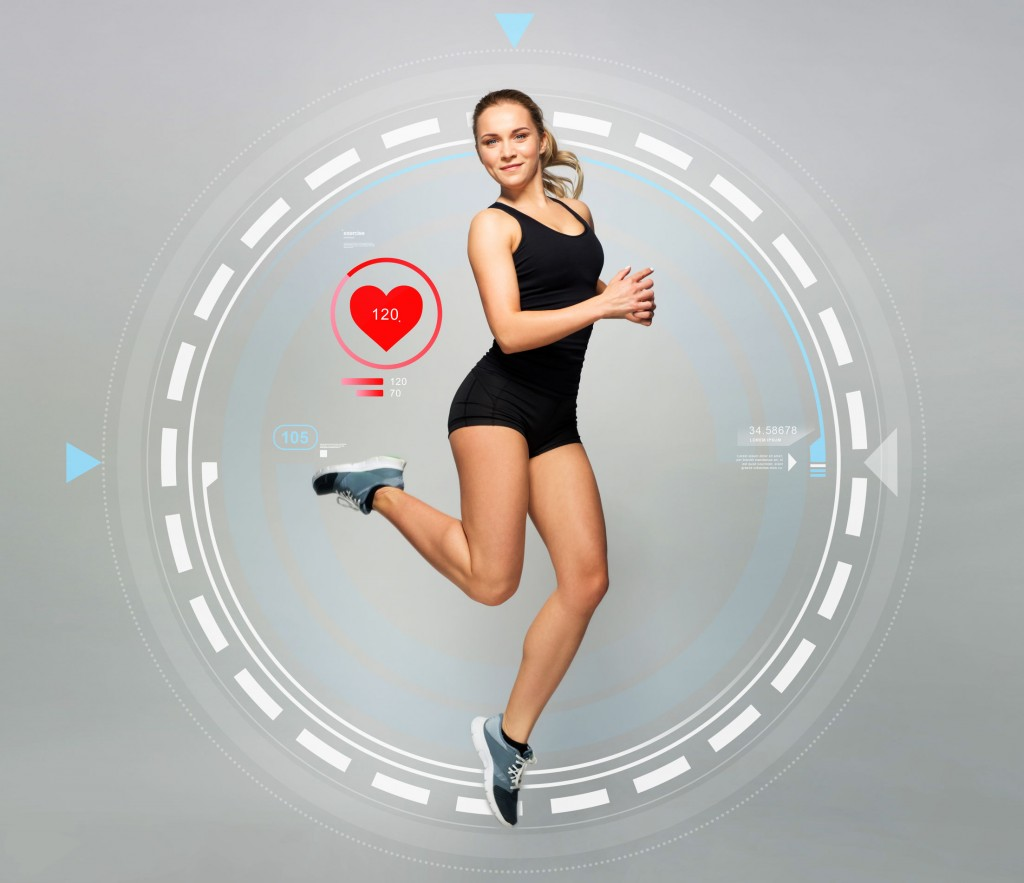 sport, fitness and people concept - young woman in black sportswear jumping with pulse